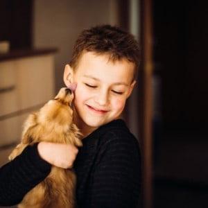 Pretty Child Hugs Little Dog